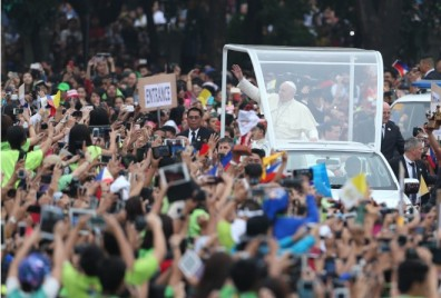 "Pope Francis waves to the crowd during ""Encounter with the Youth"" at the University of Santo Tomas."
