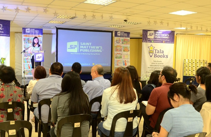 Ms. Ruth Catabijan, Business Development Manager of St. Matthew's Publishing Corporation, welcomes the crowd to the launching of Tala Books and Junior Ipon.